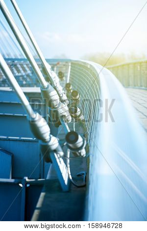 Perspective view of a modern suspension bridge on a sunny day with beautiful blue sky in the background