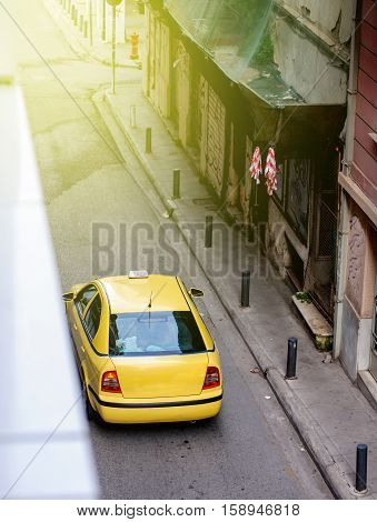 Yellow taxi car limousine waiting for customers on the streets of Athens Greece early in the morning