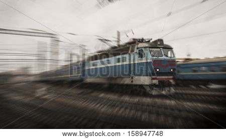The old train is driving by railroad