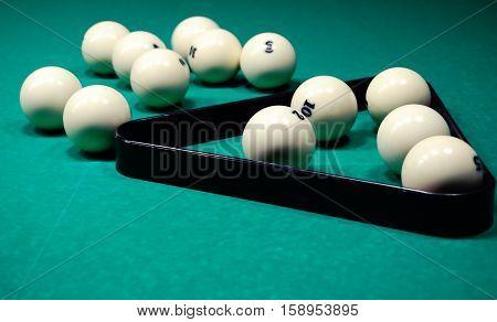 Billiard balls on a billiard table. Russian pyramid.