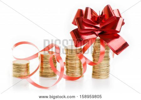 gold coins with a red gift bow. Concept of pecuniary profit.