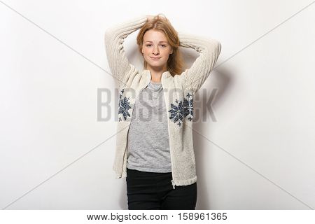Human Face Expressions And Emotions. Young Adorable Redhead Woman In Cozy Shirt Hands Behind Head Wi