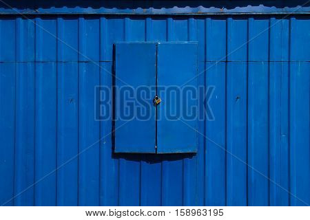 Blue metal shutters closed on the lock