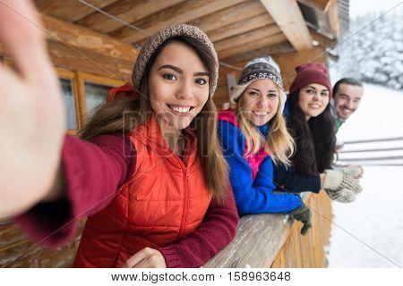 People Group Taking Selfie Photo Smart Phone Wooden Country House Terrace Winter Snow Mountain Resort Friends On Vacation