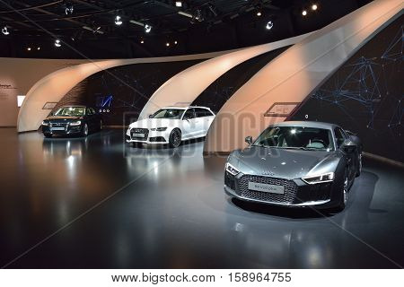 Wolfsburg, Germany - April 15, 2016. Interior view of permanent Audi exhibition in Autostadt theme park in Wolfsburg, with Audi R8 V10 Plus, RS6 and A8L W12 cars.