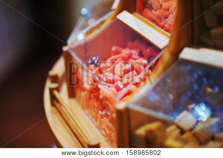 Red jelly candies and marmalade in the display case in the sales area of the supermarket