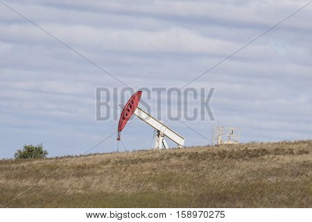 An oil well on the prairie in North Dakota