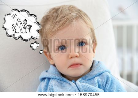 Sad little boy dreaming of happy family. Adoption, custody and childcare concept.