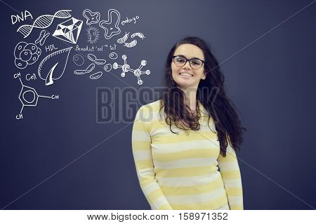 Young smiling woman on blue gray background with universum icons. Confusion.