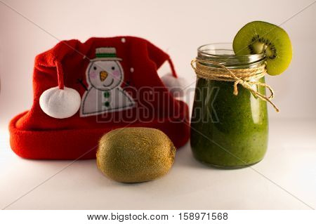 green smoothie from spinach and kiwi on a white background X MAS
