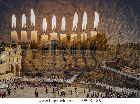 Composite image of menorah with glittering candles and wester wall in Jerusalem. The image symbolizes Jewish desires and hopes. Toned for inspiration of retro style