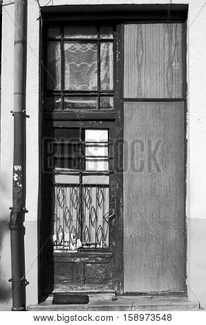 Old house door, entrance into an old building of the late '60's.