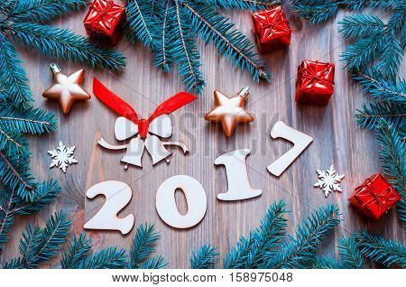 Happy New Year 2017 background with 2017 figures, Christmas toys, blue fir tree branches - New Year 2017 still life. Concept of Happy New Year 2017 holiday with New Year objects. Flat lay ,top view