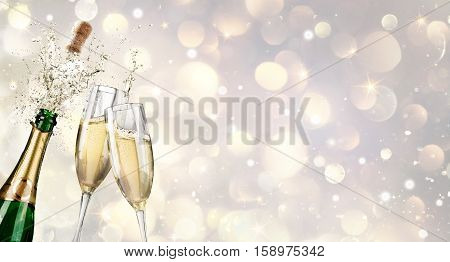 Champagne Explosion With Toast Of Flutes- Happy New Year