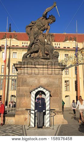 PRAGUE, CZECH REPUBLIC - SEPTEMBER 28, 2015: Entrance to Prague castle guarded by the castle guards, Prague, Czech Republic. Prague castle is the official residence of the president of the Czech republic.