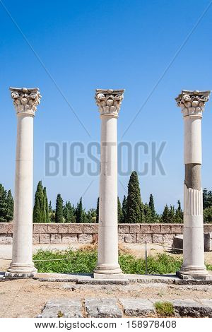 Columns at ancient site of Asclepeion (The Hippocratic school of medicine) in sunny greek day. Kos island, Greece