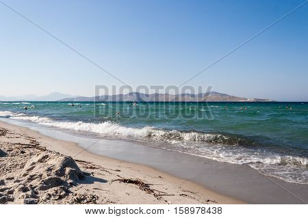 Sea and white sand beach in Tigaki. Sunny and relaxing day. Greece, Kos island