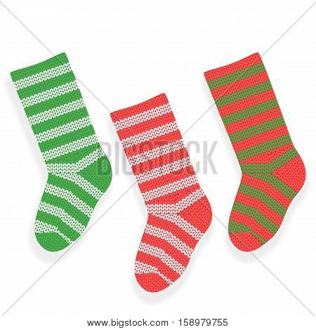 Striped christmas knitted stocking isolated on white background.