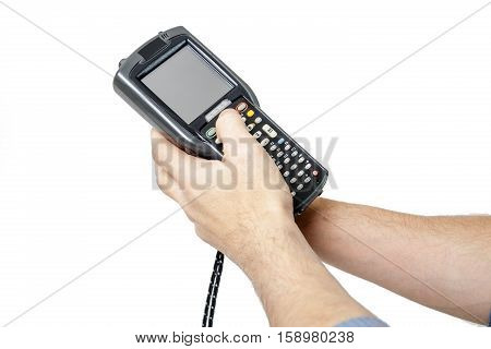 Man's hand holding a barcode scanner.  His second hand presses the button on the scanner keyboard. The scanning device is directed upwards to the left. Isolated on white background.