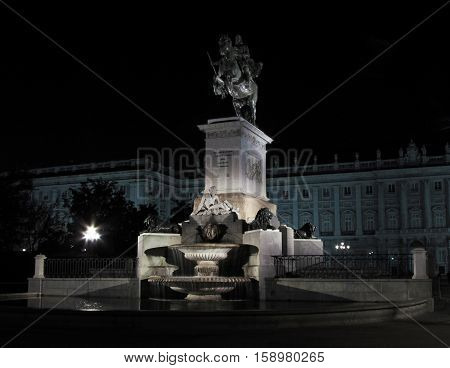 Monument to King Philip IV, A Famous Fountain in Madrid, Spain with the Royal Palace in the background (Palacio de Oriente)