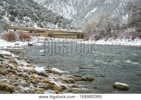 Snow storm over Colorado River and interstate highway i-80  in Glenwood Canyon at Grizzly Creek Rest Area