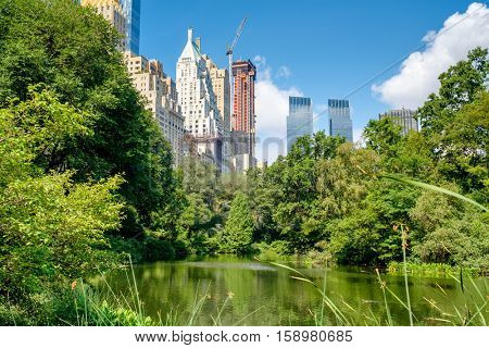 The Pond in Central Park with a view of the Central Park South skyline in midtown Manhattan, New York City