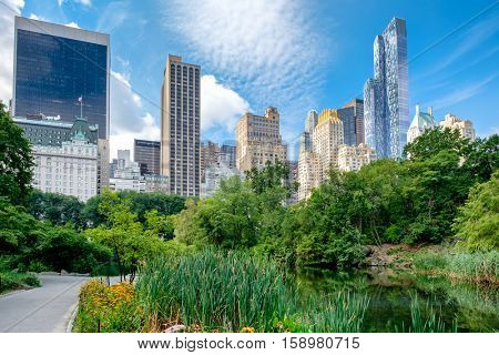 Summer scene at Central Park with a view of the Central Park South skyline in midtown Manhattan, New York City