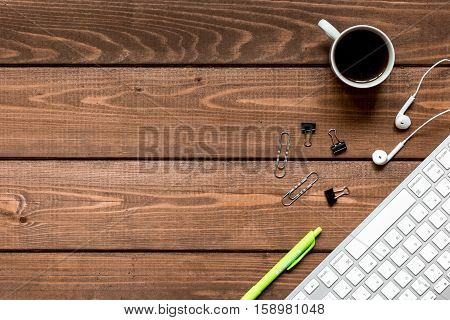 mans working place at wooden desktop with coffee top view