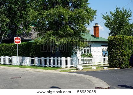 A lakefront home with a white picket fence near the Zorn Park Beach in Harbor Springs, Michigan.