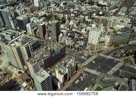 Tokyo - June 2016: Aerial view of city with traffic in sunny day.