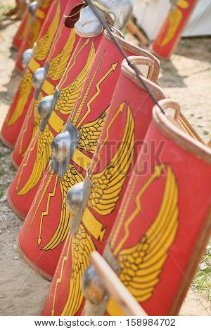 MOSCOW - JUN 06, 2015: The row of shields of soldiers in the Roman military camp at the festival Times and epoch: Ancient Rome in Kolomenskoye