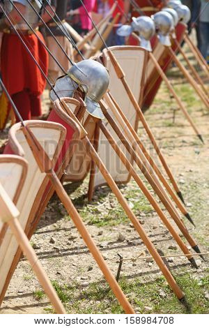 MOSCOW - JUN 06, 2015: The row of shields and spears of soldiers in the Roman military camp at the festival Times and epoch: Ancient Rome in Kolomenskoye