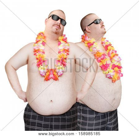 Obese men's couple in swimsuit with tropical flowers. Funny people enjoying holidays on the beach. Studio shot of two persons (only one same man in different positions) on white background.