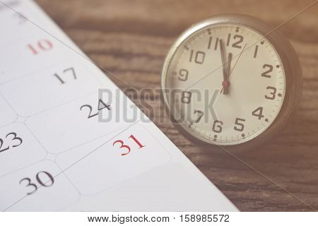 calendar of last day on month of december with time concept for new year and count down.