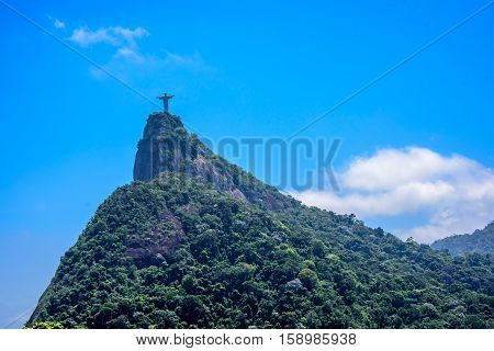 27 November 2016, Rio de Janeiro, Brazil. View on Corcovado mountain and National Park of Tijuca at sunny summer day with blue sky and white clouds