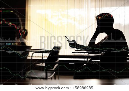 Silhouette of business man making trading online on the smart phone in meeting room or office. New ways to make economy and trading. Phone with blur trading screen copy space.