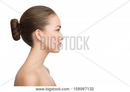 Portrait of profile charming woman with bared shoulders isolated on white background with copyspace