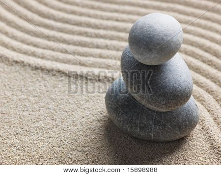 Zen stone in the sand. Background