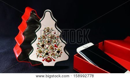 Smartphone In Red Gift Box On Black Background.