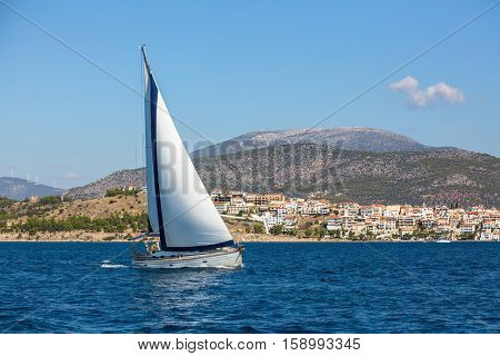 Luxury yacht boat at regatta. Sailing in the wind through the waves at the Aegean Sea.