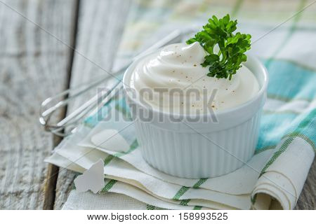 Mayonnaise sauce on wood background, copy space