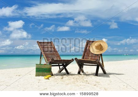 Beautiful beach with chaise lounge