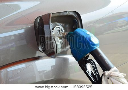 Refuelling Vehicle With Blue Gasoline Nozzle, Energy And Transportation Concpet