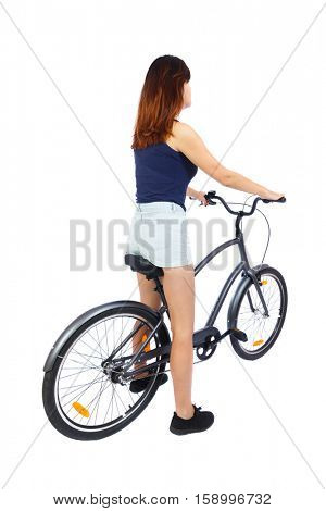 back view of a woman with a bicycle. cyclist sits on the bike. Rear view people collection.  backside view of person. Isolated over white background. Beautiful girl sits on a bicycle. view from above.