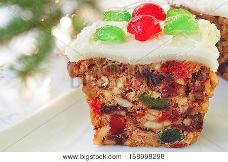 Homemade Christmas fruitcake with candied cherry decorations.