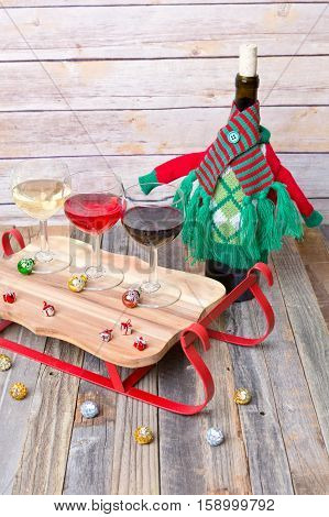 Three glass wine flight with colorful holiday decorations