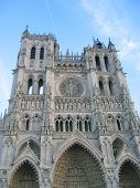 Front view of the cathedral with blue sky - Amiens - France. poster