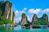 Floating fishing village and rock island in Halong Bay Vietnam Southeast Asia. UNESCO World Heritage Site. Junk boat cruise to Ha Long Bay. Landscape. Popular landmark famous destination of Vietnam poster