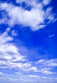 The blue sky and beautiful white clouds. poster
