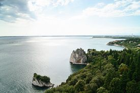 Adriatic sea with the ruins of the old Duino Castle near Trieste Italy.